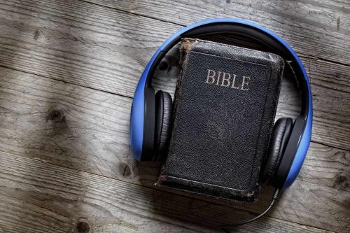 38970288-holy-bible-and-headphones-concept-for-modern-religious-education-podcast-or-help-with-hearing-for-bl.jpg